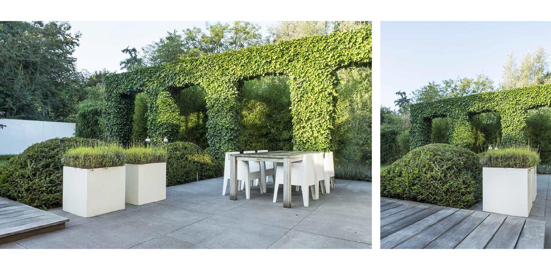 klimopbogen langs terras in grootformaat tegels met witte plantenbakken villatuin Naarden. In het strakke en moderne tuinontwerp zijn enkele niet alledaagse grote 'spannende' lijnen en elementen opgenomen - Denkers in tuinen.